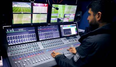 An operator at HD Protek works on the new Calrec Summa2 audio console.