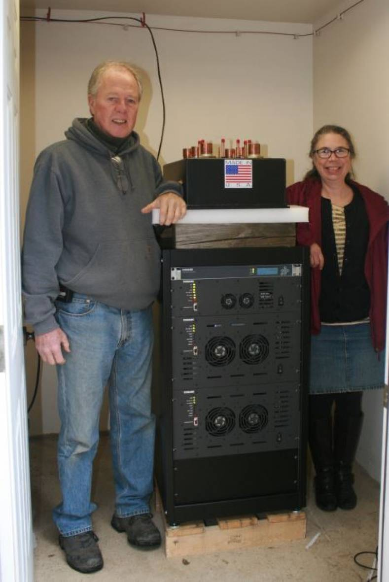 Harpswell (MA) Community TV's Dave Chipman and Donna Frisoli stand next to its new LPTV-8000 and LEX2210 Encoder/MUX.
