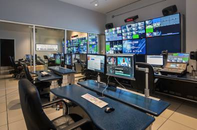 The advanced A/V control room inside AT&T Stadium in Arlington, Texas, features a series of elevating console desks from TBC Consoles.