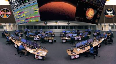 "Custom Consoles EditOne desks prominently featured on the ""Mars 1001"" mission control room set."