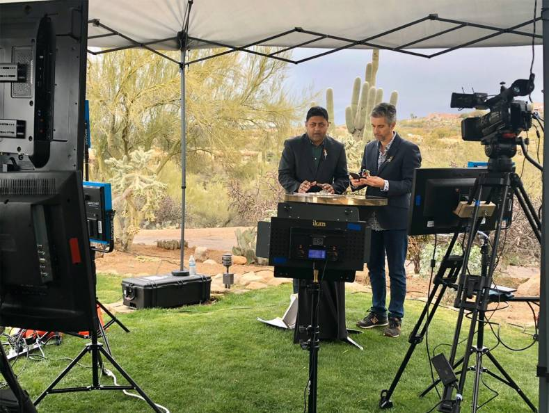 TJC presenters broadcast live from the Arizona desert using Dejero's Smart Blending Technology. Photo courtesy Richard Coxhill.