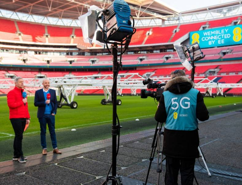 BT Sport's 5G remote production test with director of mobile strategy Matt Stagg (right),with presenter Matt Smith at Wembley Stadium