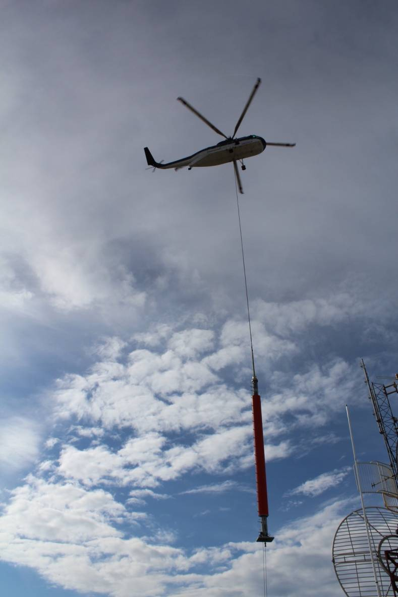 A helicopter lifts KWHB's new Channel 16 repack antenna into position.