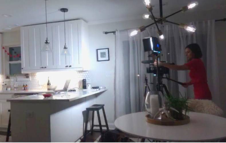 This reporter is setting up for a solo live shot from her kitchen. Who would have thought 'phoning it in' would become the new normal?