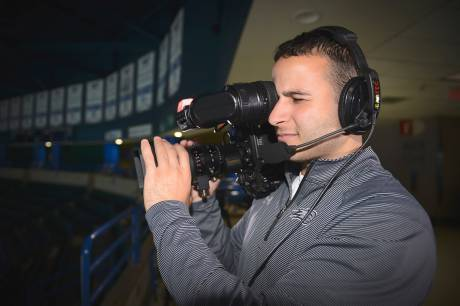 Sebouh Majarian, assistant director of new media at UMass Lowell, operates one of the Tsongas Center's four Hitachi Z-HD5000 cameras.