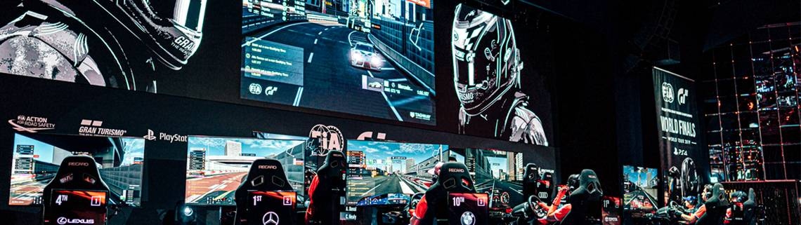 The 2019 FIA Gran Turismo World Championship stage. Note the portrait live stat displays behind the driver