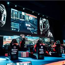 The 2019 FIA Gran Turismo World Championship stage. Note the portrait live stat displays behind the driver's seats. Getty Images Photo.