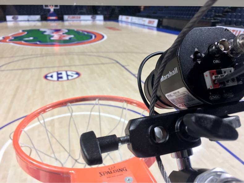 "Two ""Slamcams"" use the Marshall CV343-CSB camera with a Fujinon wide angle lens mounted to the UF basketball venue's stanchion hardware."