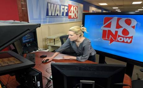 WAFF producer Kathryn Rickmeyer prepares a news conference stream to go live on WAFF 48's Facebook page and OTT platforms.