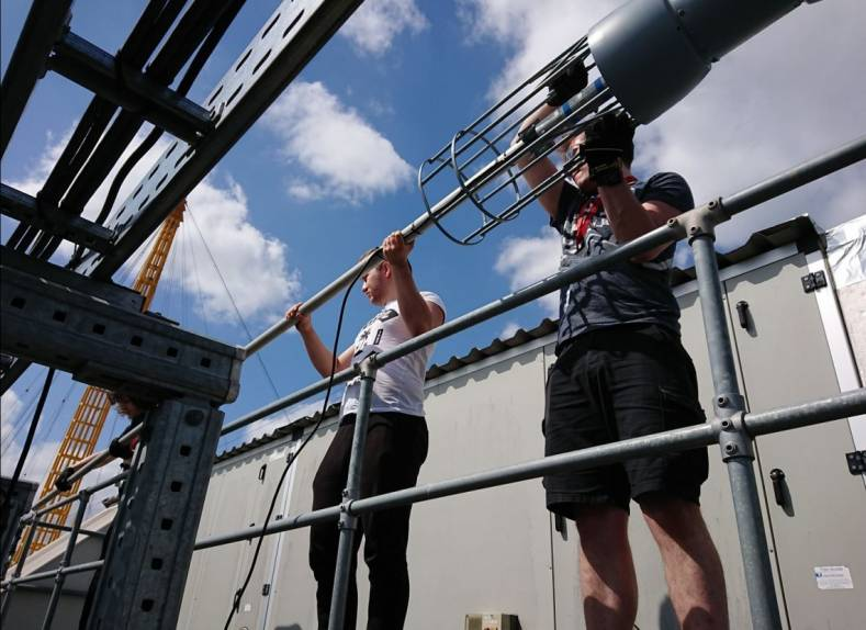 Ravensbourne University engineers install a Rohde & Schwarz model HK033 antenna for its specially-licensed DVB transmission.