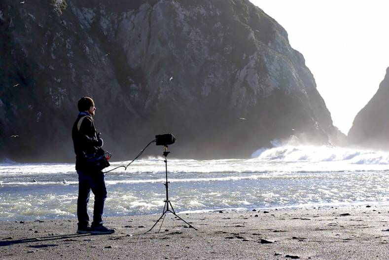 Eric Mooney recording crashing waves in stereo.