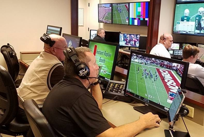 The control room at SEC's Video Centre in Birmingham, AL, with officials communicating over Clear-Com intercom.