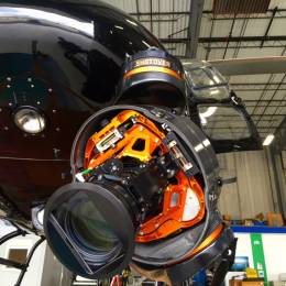 The Canon camera and telephoto lens are mounted inside a Shotover FS 1 gimbal under the helicopter.