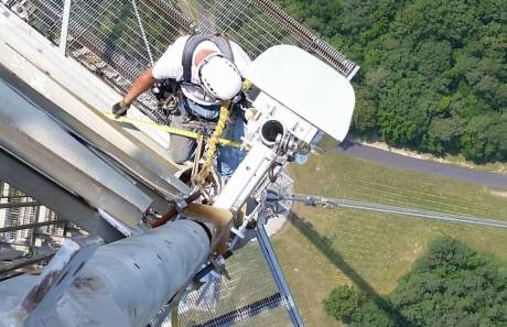 Installer double-checks the measurements while bolting a Channel 39 antenna to the WRAL tower.