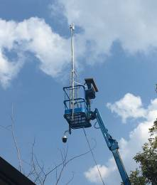 Wi-Fi antennas covering several square miles topped a 60' Genie Lift, along with a hanging PTZ IP security camera for beauty shots.