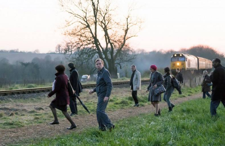 Trainman Ed Jacobson (center) leaves Woking station for the unknown destination of Macon Heights in the film,