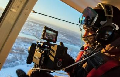 Matthieu Cowan shooting a RED camera with Hypercore SLIM HC8 battery out of a helicopter in Montreal.