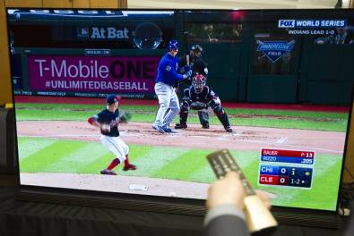 The first live ATSC 3.0 broadcast of a major pro sporting event: An ATSC 3.0-equipped 65-inch LG OLED TV at Cleveland's Progressive Field received a live over-the-air simulcast of the 2016 World Series from station WJW-TV. (Photo: Phil Long/AP for ATSC).