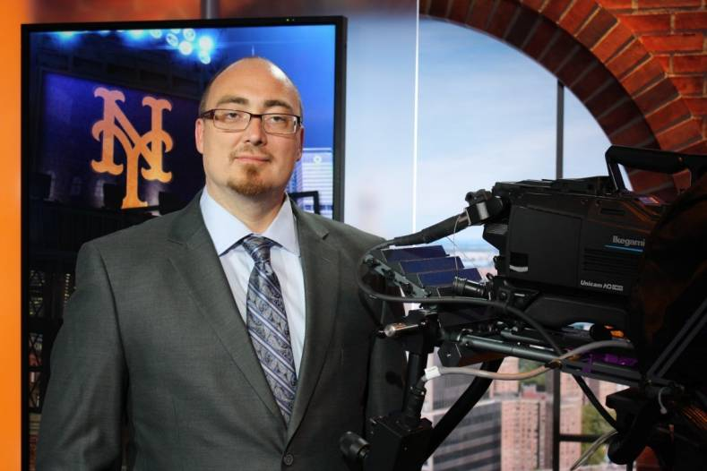 Nathaniel Hayne, senior video and lighting technician for SNY, with one of SNY's eight Ikegami HDK-95C portable HD cameras.