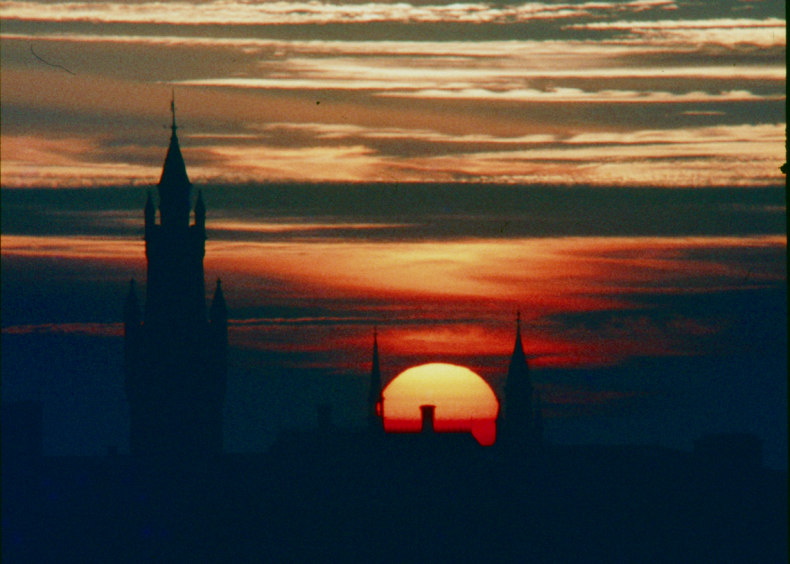 Fig. 2.  The Peace Palace in den Haag, Netherlands, with an extremely orange sun setting behind it.  Photograph: John Watkinson, Mamiya DSX 1000.