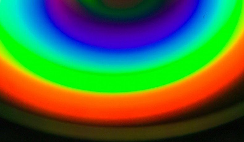 Fig.4 - A fluorescent light seen in a recordable Compact Disc used as a diffraction grating. As rainbows go, it's rubbish, but it looks white to the HVS. That's metamerism at work.  Incidentally, it is an interesting exercise to see what this image looks like on different types of display. The difference between a computer screen and a flat screen TV may be quite striking. (Photograph: John Watkinson, Mamiya 645 with macro lens).