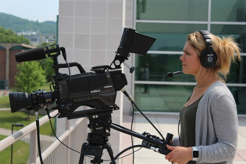 Binghamton University Athletics Communications Assistant Sydney Harbaugh operates one of the university's four Hitachi Z-HD5000 cameras. Photo credit: Binghamton Athletics.