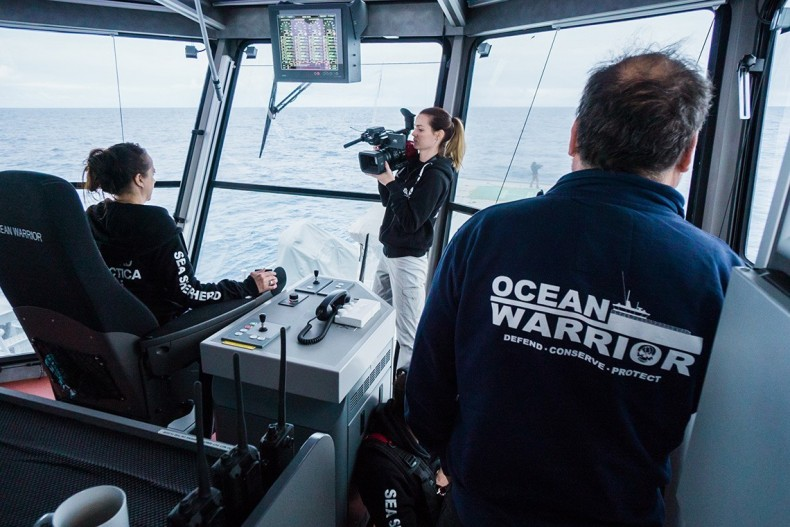 Producer and camera operator Ashleigh Allam films with the DVX200 on the bridge of the M/Y Ocean Warrior off the coast of Antarctica. © Gavin Garrison/Sea Shepherd Global.