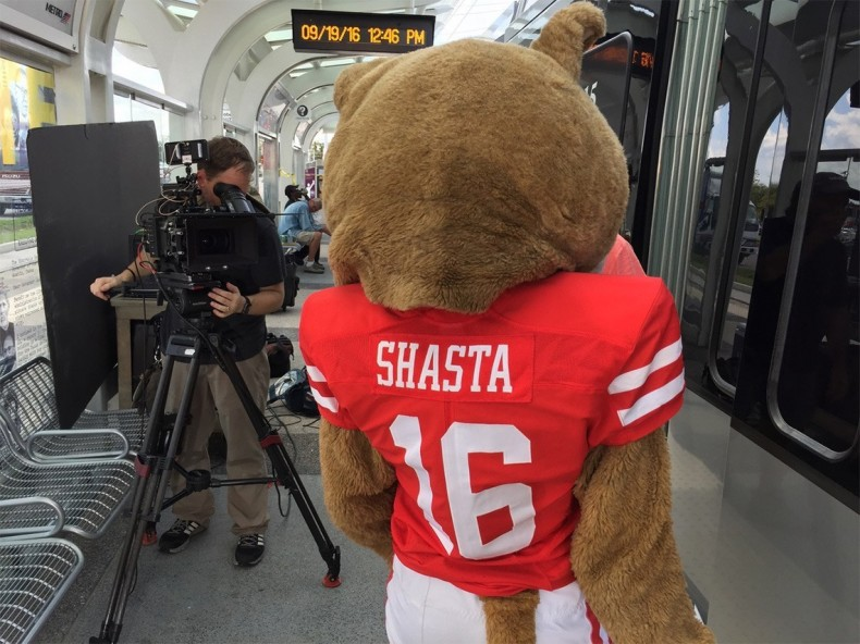 Camera operator Wyatt Cagle lining up a shot with the UH mascot at the METRO station outside TDECU Stadium.