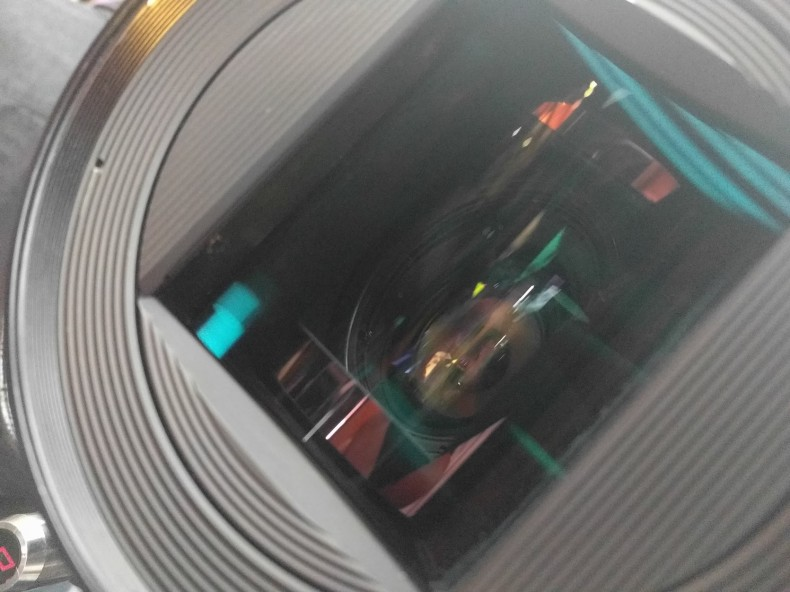 The cylindrical element is at the front of this lens; occasionally they're at the back, which changes behaviour.