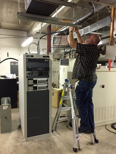 Two years ago, GatesAir installed a new frequency-agile Channel 49 KRBK 5 kW SFN transmitter in the KOLR transmitter building. Today it's the Channel 22 standby transmitter. Shown, GatesAir installer Carl Williams.