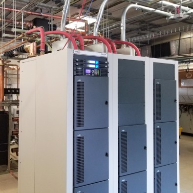 This 3-cabinet GatesAir ULXTE-80 makes 50.1 kW TPO. Note the liquid cooling lines above the cabinets.
