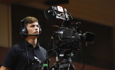BYU-Hawaii student Christopher Johnson operates one of the school's HITACHI SK-UHD4000 Ultra HD cameras.<br />Photo credit: Monique Saenz.