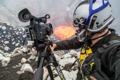 Just another day for Bradley Ambrose, shown here shooting on the rim of the Ambrym volcano with his Miller Air Tripod.