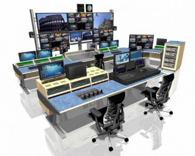 The video production desks are designed for simultaneous use by a camera input controller seated at left, graphics assistant (center) and vision mixer (right).]