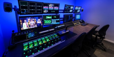 The Camera Control suite features a 3.1 meter wide desk with six 4 RU-high sloping equipment bays and is used to control incoming camera feeds.