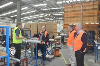 RFS technicians and John Lyons (center) inspect transmission line in the RFS factory.