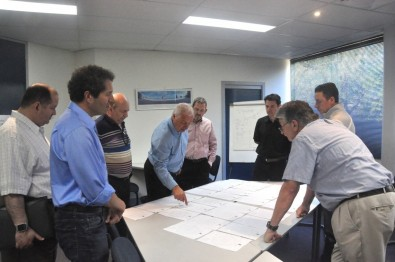 The TDO team reviews the test plots of the PEP-40 antenna at the RFS test range.