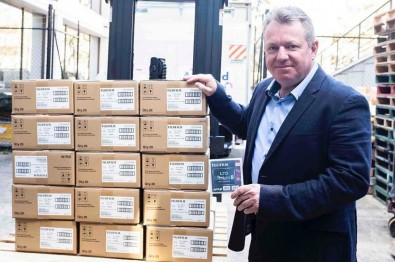 Dicker Data National Business Development Manager Paul Tutton poses with Australia's first delivery of Fujifilm LTO-8 tapes.