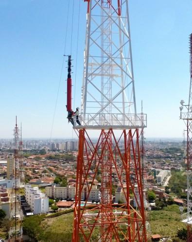 The rigging crew raises a new antenna.