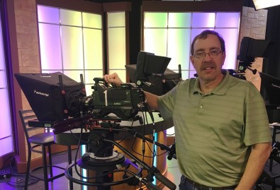 Jon T. Wenger, chief engineer for James Madison University's School of Media Arts & Design, with one of the school's Hitachi Z-HD6000 cameras.