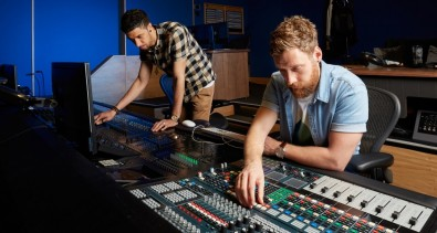 Sound mix technician Kobi Quist and junior mix technician Jack Cheetham in one of Abbey Road studios' new film-mixing studios with IHSE KVM Technology.