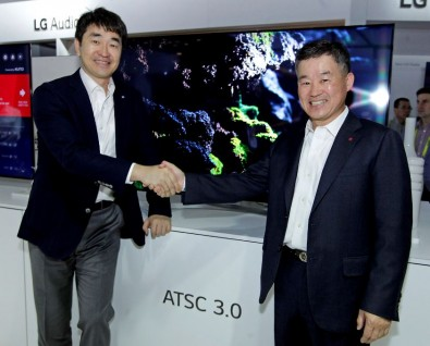 Suk-Mynn Yoon, CEO and Vice Chairman of SBS Media Holdings, (left) is briefed at CES 2017 by Dr. Jong Kim, Senior Vice President, LG Electronics Office of the CTO and President of LG's Zenith R&D Lab.