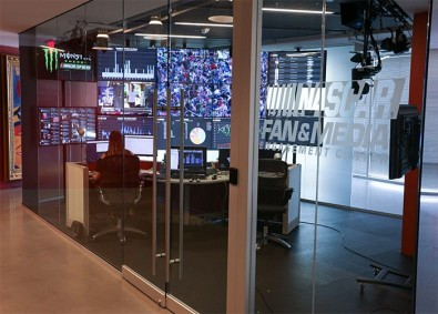 NASCAR Productions' facility includes a fan engagement area where staff track and stimulate the different drivers' activity on social media.