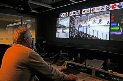 """Mike Murphy, NHL senior vice-president of hockey operations in the NHL's """"Situation Room."""" (Photo: John Kryk/QMI Agency)."""