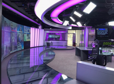 The school's newsroom is the first in Qatar to be fully automated, with robotic systems that enable a single operator to run an entire show.