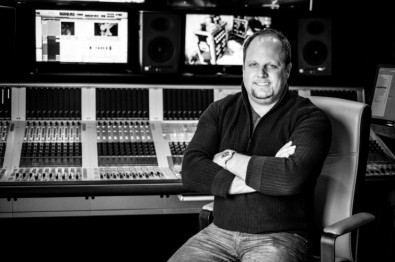 Nic Dugger president and owner of TNDV. Behind him is a Soundcraft Vi3000 digital audio console mounted in TNDV's Elevation truck.