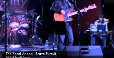 "Noland (far right) onstage with her band ""Brave Pursuit""."
