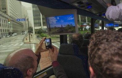 Expert viewers were provided nearby displays to observe mobile reception. AP photo courtesy LG Electronics USA.