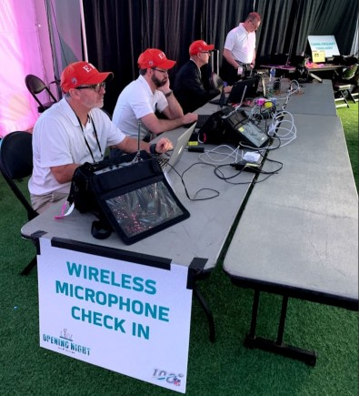 The EFC team is ready to check out wireless mics before they are checked in.