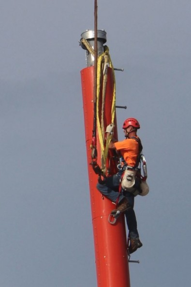 A tower rigger separates the yoke and hook.